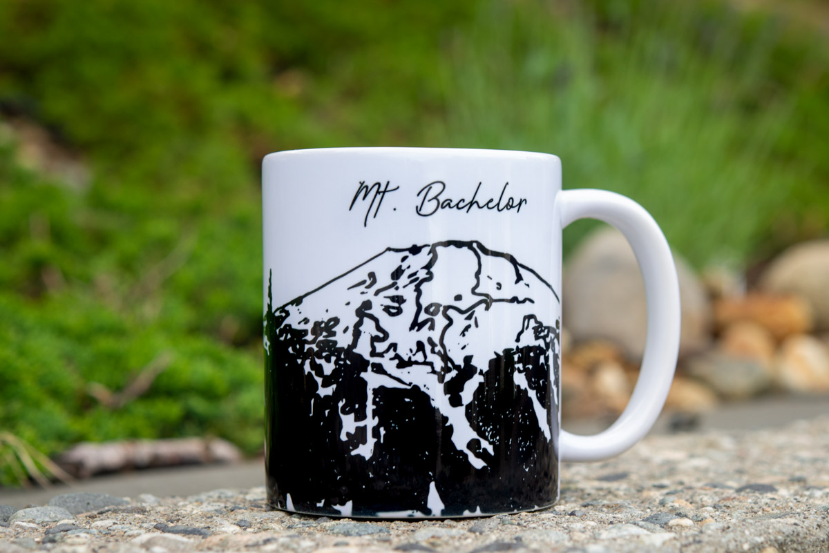 Bring the wilderness indoors with our 11-ounce Mt. Bachelor mug!